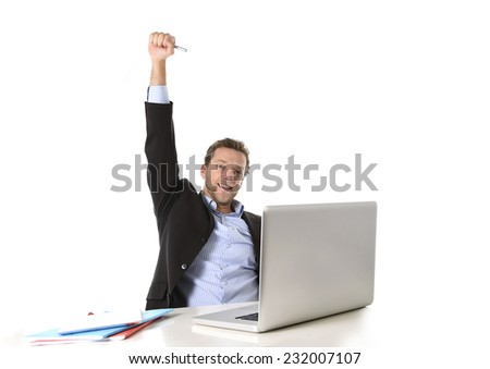 young attractive businessman happy and hectic at office work sitting at computer desk satisfied celebrating higher salary smiling isolated on white background  - stock photo