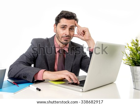 young attractive businessman in suit and tie working in stress at office computer laptop looking desperate and frustrated in work and business problem concept - stock photo