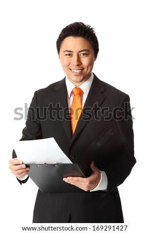 Young attractive businessman wearing a suit and tie, holding a folder. White background. - stock photo
