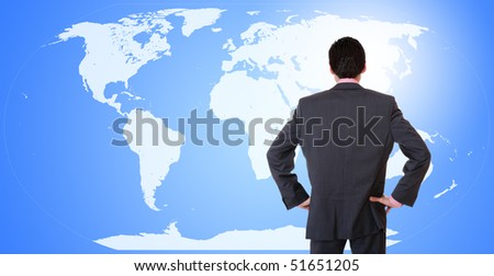 Young attractive businessman with world map in background - globalization - stock photo