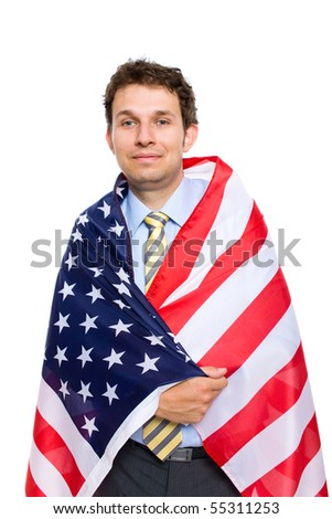 young attractive businessman wrapped in american flag, studio shoot isolated on white background - stock photo