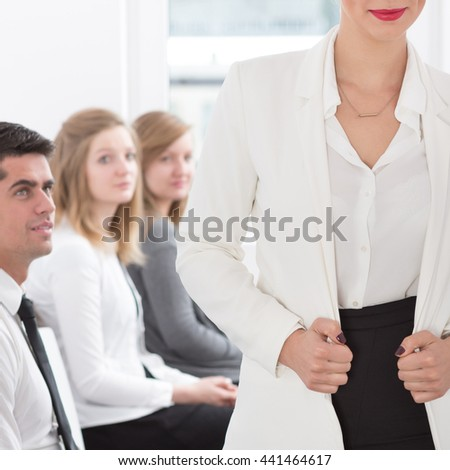 Young attractive businesswoman and her team - square - stock photo