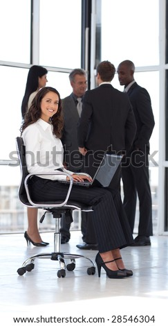Young attractive businesswoman in office working - stock photo