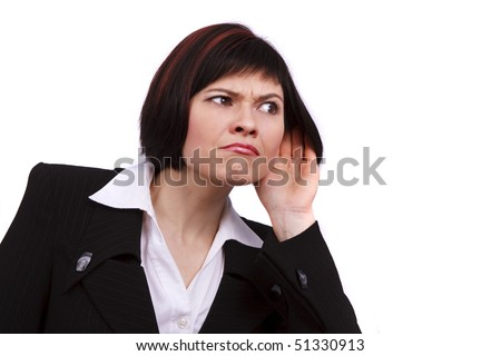 Young attractive businesswoman listening gossip isolated on white. Beautiful business female eavesdropping. Business woman trying to hearing the sound around her. - stock photo