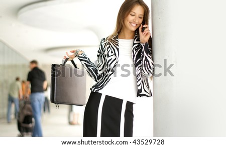 Young attractive businesswoman or a student talking on the phone - stock photo
