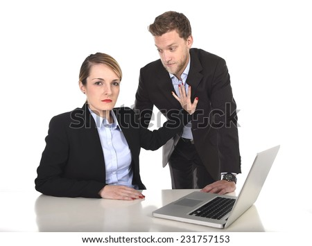 young attractive businesswoman suffering sexual harassment and abuse of colleague or office boss flirting in inappropriate behavior at work with excessive familiarity in work relationship concept - stock photo