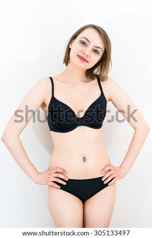 young attractive caucasian woman in lingerie  - stock photo