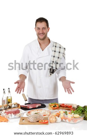 Young attractive chef caucasian male with uniform showing diversity of uncooked meals. Studio shot. White background - stock photo