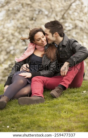 young attractive couple having fun in spring park - stock photo