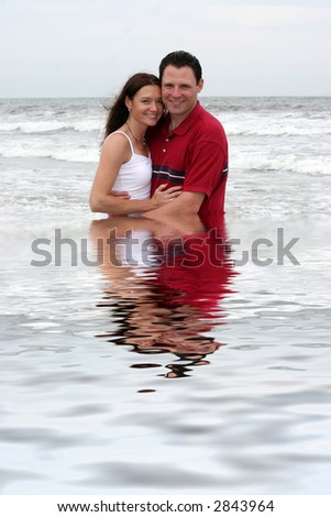 young attractive couple in water - stock photo