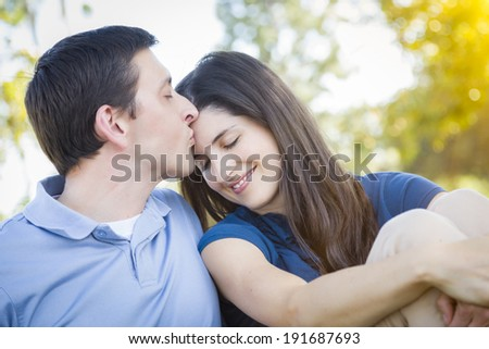 Young Attractive Couple Intimate Portrait Outdoors in the Park. - stock photo