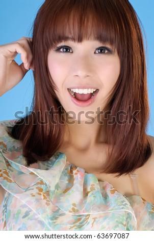Young attractive elegant Asian woman, closeup portrait. - stock photo