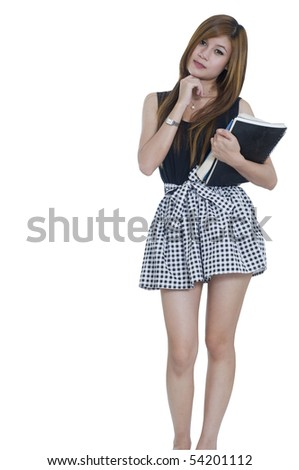 Young attractive female Asian student wearing a dress and holding her school books - stock photo