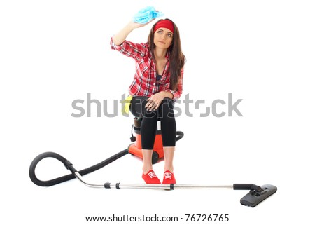 young attractive female cleaner in red shirt sits on vacuum cleaner,  isolated on white background - stock photo