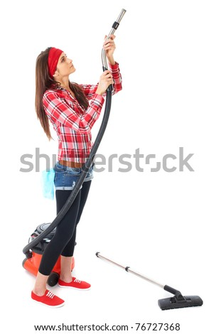 young attractive female cleaner in red shirt use vacuum cleaner, isolated on white background - stock photo