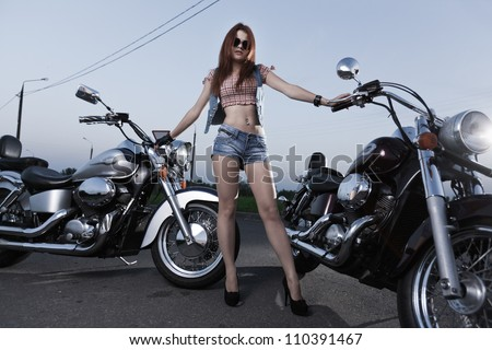 Young attractive girl and motorcycle - stock photo