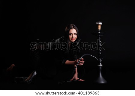 Young attractive girl in elegant dress and khalil mamoon hookah in studio.  - stock photo