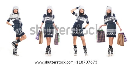 Young attractive girl in native scandinavian clothes makes shopping isolated on white - stock photo