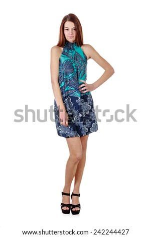 Young attractive girl in short dress isolated over white background - stock photo