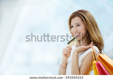 Young attractive girl with a credit card  - stock photo