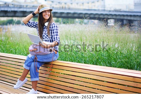 Young attractive girl with a laptop - stock photo