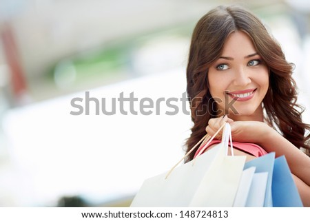 Young attractive girl with shopping bags - stock photo