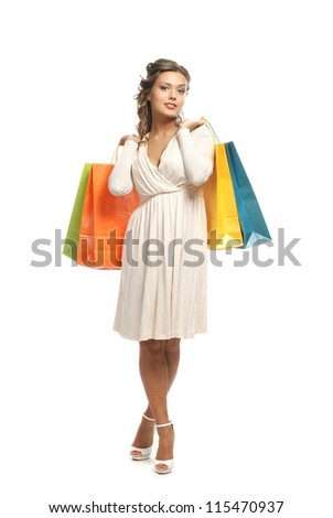 Young attractive girl with the shopping bags isolated on white - stock photo