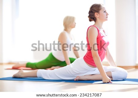 Young attractive girls do yoga. Seriya - stock photo