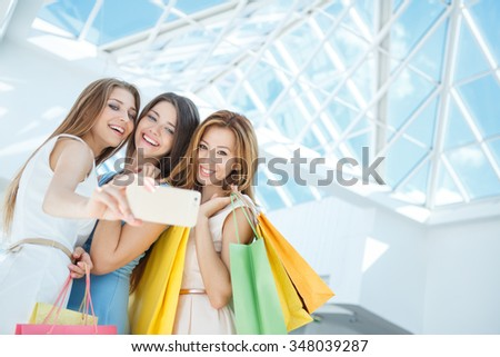 Young attractive girls making selfie - stock photo