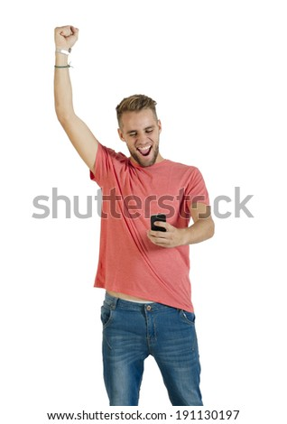 Young attractive guy receiving good news on mobile phone - stock photo