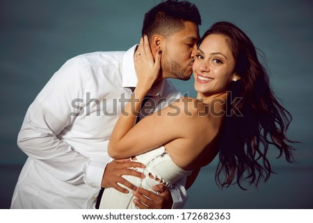 Young attractive happy couple posing outdoor. - stock photo