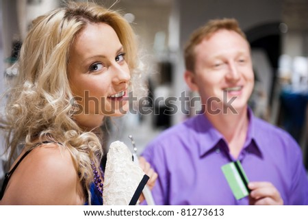 Young attractive happy couple shopping at mall. - stock photo