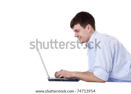 Young attractive happy man using laptop for surfing  the internet. Isolated on white background. - stock photo