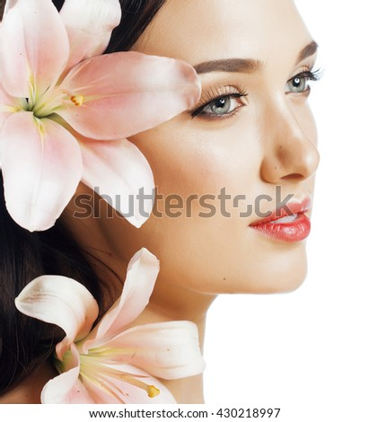young attractive lady close up with hands on face isolated flower lily brunette spa - stock photo