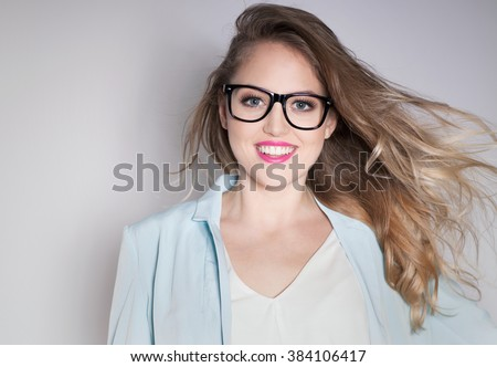 Young attractive laughing blonde smart happy business woman wearing glasses expressive portrait beauty concept - stock photo