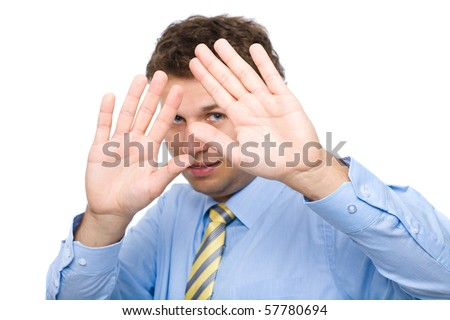 young attractive male cover his face, try to hide, shows keep away from me gesture, studio shoot isolated on white background - stock photo