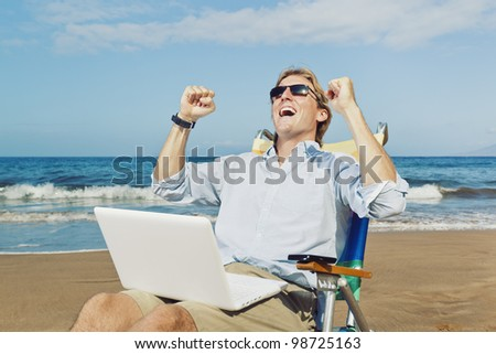 Young Attractive Man Celebrating Success, Working on Computer at the Beach - stock photo
