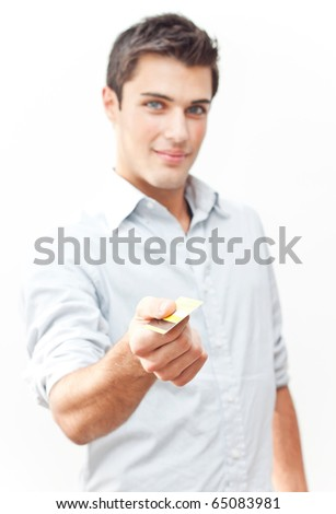 Young attractive man giving credit card - stock photo