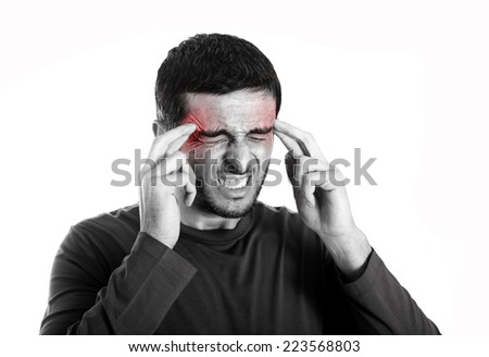 Young attractive Man with Beard suffering Headache and migraine in pain and ache face expression Isolated on White Background touching his head with red color on ache area - stock photo