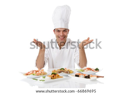 Young attractive nepalese man chef showing diversity of oriental meals on plates. Studio shot, white background. - stock photo