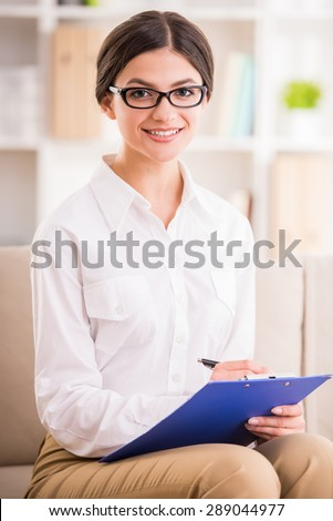 Young attractive psychotherapist listening about problems of her patient. - stock photo