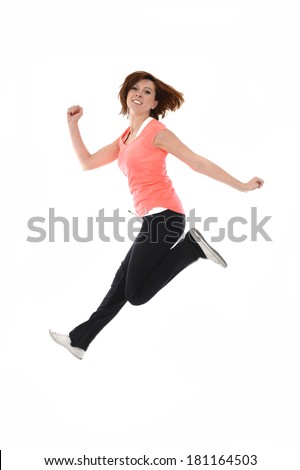 young attractive red hair sport woman feeling happy, smiling and having fun, jumping with energy and dancing in healthy lifestyle concept isolated on white background - stock photo