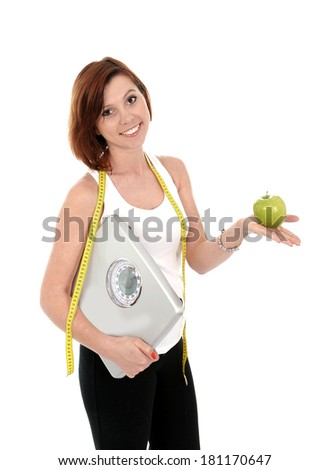 young attractive red hair sport woman holding apple and measuring tape wearing sport clothes isolated on white background in successful diet and healthy nutrition concept - stock photo