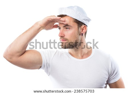 Young attractive sailor against white background - stock photo