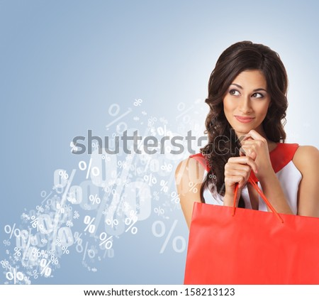 Young attractive shopper girl with the bags (discounts and sales concept) - stock photo