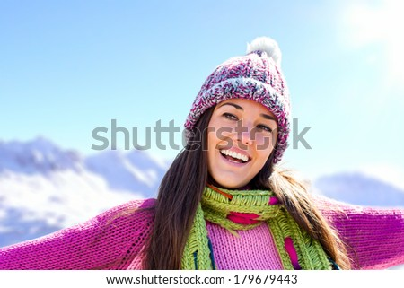 Young attractive snow girl wearing pink jersey and beanie outdoors. - stock photo