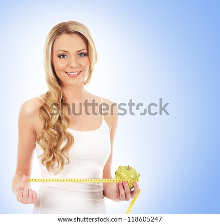 Young attractive sporty woman  over blue background - stock photo
