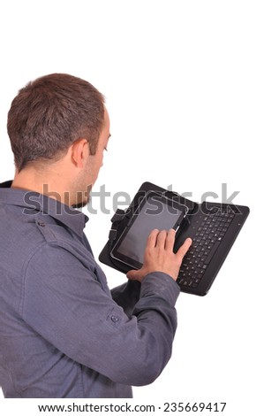 Young attractive student typing on his smart phone - stock photo