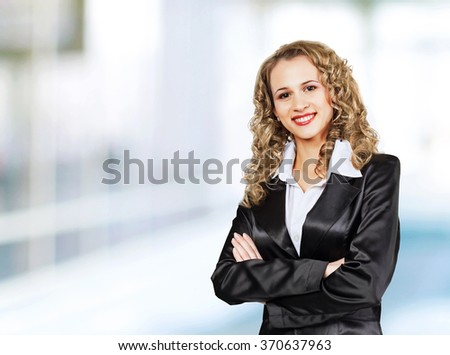 Young, attractive, successful business woman, confidently looking forward. - stock photo