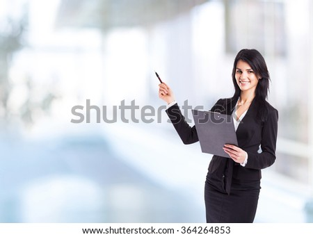 Young, attractive, successful business woman, studies the charts and diagrame Finance company. - stock photo